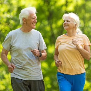 active elderly couple out for a jog