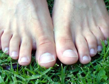 bare feet on green grass