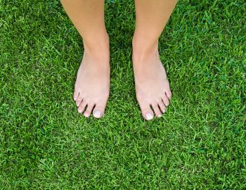 bare feet on lush green grass