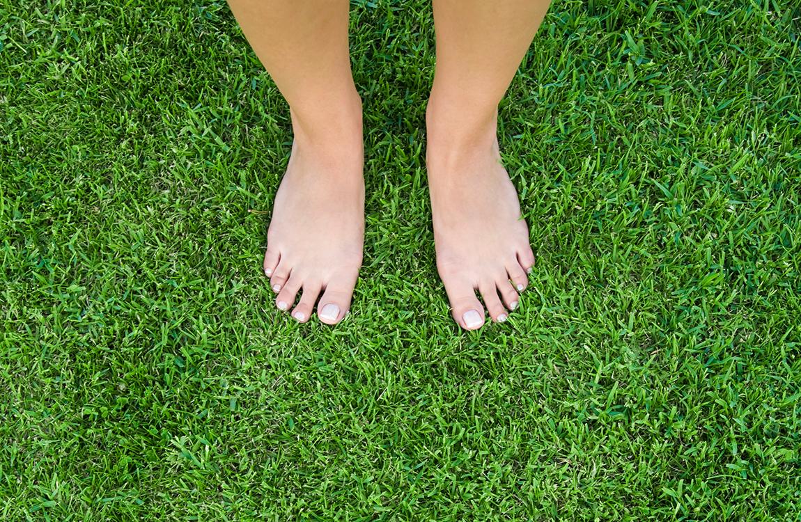 bare feet on lush green grass